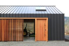 Corrugated metal exterior for upstairs bedroom.