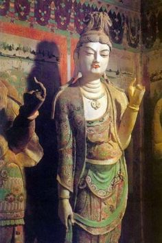 Doing meditation doesn't mean you have to sit with crossed legs - a standing Buddha in deep contemplation at Dunhuang Grottoes, produced during the Tang Dynasty (618 - 907)