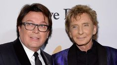 Garry Kief, left, and Barry Manilow in February 2016. (Kevork Djansezian / Getty Images)  IT'S ALWAYS remarkable how someone can have several children with a woman and  turn around and claim to be gay.  Since most of his concert is centered around his mother.....