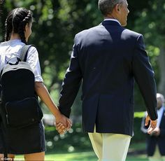 The President held his oldest daughter's hand tight as they walked across the White House ...