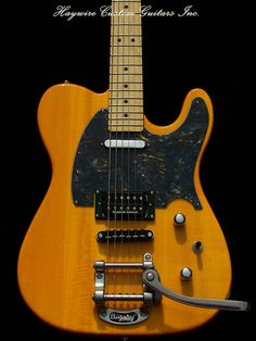 http://www.haywirecustomguitars.com   The Haywire Tremolo Tele is one tricked out Tele®. The most prominent feature is a  tremolo. We couple this with a Tune-o-matic bridge for tuning stability.  The body has a Strat®-style tummy cut for extra comfort. http://www.haywirecustomguitars.com