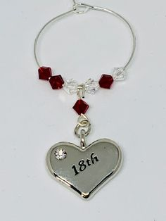 Garnet Wine Glass Charm - set with a silver plated heart engraved with - finished with Garnet and Clear Swarovski Crystals Garnet is the birthstone for January Wine Glass Charms, Organza Bags, Heart Charm, Birthstones, Garnet, Silver Plate, Swarovski Crystals, 18th, January