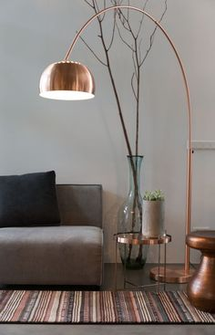 35 Cool Eye-Catching Metallic Accents for Modern Interior : 35 Cool Eye Catching Metallic Accents For Modern Interior With Grey Sofa And Dark Rug Design