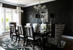 Kristin Drohan Collection and Interior Design: A dramatic black and white dining room with tonal damask wallpaper. The Surya Modern Classics rug from designer #CandiceOlson mirrors the damask pattern in a grand scale. (CAN-1951)