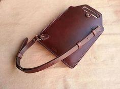 Holder for the I-pad mini??   Cross-body, stiff, skinny adjustable strap.