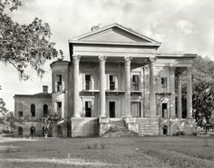 """1938. Iberville Parish. """"Belle Grove. Vicinity of White Castle. Greek Revival mansion of 75 rooms. Built 1857 by John Andrews, who sold it to Stone Ware. Occupied by Ware family until circa 1913."""" What was left of Belle Grove, reputedly the largest plantation house in the South, burned to the ground in 1952."""