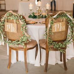 Don your sweetheart chairs with charming Mr. and Mrs. Signs.Related: 25 Pretty Head Table Ideas: From Big Traditional to Intimate Sweetheart