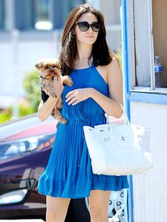 Emmy Rossum's pup Cinnamon is SO cute! We love the brunette bombshell's alluring black cat-eye sunnies too, of course!