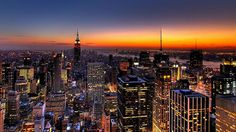 Manhattan at dusk, New York City, New York, USA, viewed from the Rockefeller Center on 6th Avenue & West 50th Street. The tall building on the left of centre is the Empire State Building on 5th Avenue & West 34th Street. https://www.google.ca/maps/place/Rockefeller+Plaza,+45+Rockefeller+Plaza,+New+York,+NY+10111,+USA/@40.7538288,-73.9888441,15z/data=!4m5!3m4!1s0x89c258fed13413e3:0x5c62dc09ad40a02e!8m2!3d40.759168!4d-73.9796557