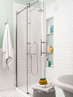 A glass shower enclosure visually expands the bathroom and maintains its feeling of openness. A large built-in niche adds plenty of storage for soaps and scrubs. Subway tile on the walls keeps the update affordable./