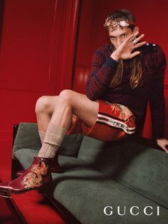 Artist Valerio Sirna, who also walked the Gucci Fall Winter 2018 fashion show, stars in the Gucci Cruise 2018 campaign shot by Mick Rock. Valerio wears athletic-inspired short pants and boots with an embroidered dragon appliqué. Creative director: Alessandro Michele Art director: Christopher Simmonds