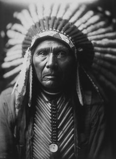 Light camera left overhead with light spilling to right eye and right cheek in shadow.  Edward S. Curtis is considered to be one of the finest photographers of the early 20th century.