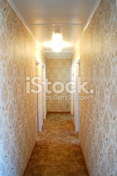 Looking down a Hallway. Lit by an original Hallway light and.