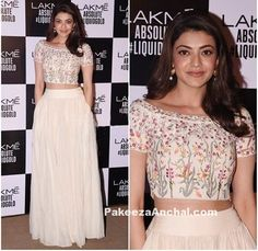 Kajal Agarwal looked stunning in Cream colored crop top with floral emboirdery and a full lenght cream colored long skirt designed by Anita Dongre. She wore this beautiful attire with minimal make-up and stole the show at Lakme Fashion Week 2017