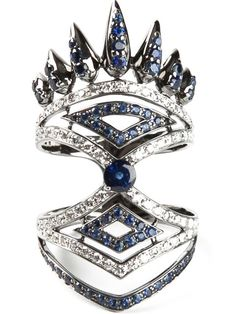 18kt white gold pavé ring from Nikos Koulis featuring 0.47ct diamond embellishing and 1.34ct blue sapphire embellishing.