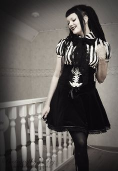 #Goth girl in Lolita dress with skeletal bodice embossed frame