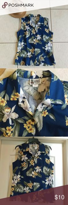 """Aloha Republic Hawaiian Shirt This Hawaiian shirt is made in Hawaii! The background is navy blue and it really accents the beautiful floral design. It measures 19""""s from pit to pit and is 24""""s long from the shoulder to the bottom of the hem. This medium will fit a size 8 in women's sizes. This has only been worn two times and is in excellent condition.                15% DISCOUNT ON BUNDLES! Aloha Republic Tops Blouses"""