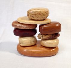 Handcrafted scroll sawn, sculpted wood jewelry or keepsake box designed to look like a pile of small rocks with four drawers. by SolsWoodworkingShop on Etsy