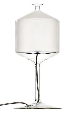 "Bonne Nuit lamp BONNE NUIT TABLE LAMP $780.00  From designers Michele De Lucchi and Alberto Nason for Produzione Privata, made in Italy, the Bonne Nuit Table Lamp serves light at the table, a fine glass goblet covered with a glass cupola diffuser.  Table standing luminaire with transparent blown borosilicate glass goblet base and sandblasted brown borosilicate glass cupola.  Total Size: 6.7""D x 13.8""H inches Requires one 14 watt, E14 base CFL light bulb; not included."