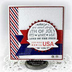 God Bless the USA by booga3 ~ Splitcoaststampers ~ Stamps: Graphic Greetings Patriotic, Stars & Stripes (Taylored Expressions) ~ Paper: June Project Pantry (Taylored Expressions) ~ Ink: Memento Gray Flannel, Memento Lady Bug (Tsukineko) ~ Accessories: Taylored Dies: Pinking Circles, Banner Stacklets 1, Fly Your Flag 2, Stars Impressions Plate (Taylored Expressions); Standard Circle Nestabilities – SM, LG (Spellbinders); Wood veneer stars (Studio Calico), Foam tape, Thread, Sewing machine.