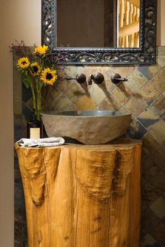 Rustic Pedistal Sink for half-bath? This bathroom features a great rustic look with the combination of a stump base for a natural boulder pedestal sink and a stone tile back splash. Home built by Summit Handcrafted Log Homes . Log Cabin House Plans, Log Cabin Homes, Log Cabins, Mountain Cabins, Mountain High, Into The Woods, Pedestal Sink, Vanity Sink, Vessel Sink