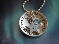 Love You to the Moon and Back Birthstone Crystal Charm Necklace. $48.00, via Etsy.