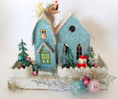 A lot of people buy Christmas villages, but our next door neighbor, Mrs. Marsden made her's. I always liked it because it never looked just exactly like anyone else's.     Vintage Blue Cardboard Christmas House