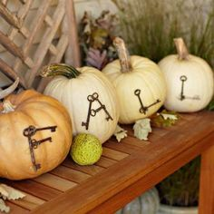 Put these welcoming pumpkins on your porch ... attach skeleton keys with straight pins! | 18 easy autumn decorations | Living the Country Life | http://www.livingthecountrylife.com/fall-decor/