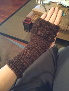 Cabled Arm Warmers ala Clare in the STARZ series Outlander. I think if I did these I'd increase the stitch number bracketing the cable so it stands out a bit more.