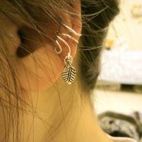 No piercing required! Ear cuff hugs around the ear cartilage. Features two swirls wrapping around from the back of the cuff to sit on the ear lobe with a leaf at one end. Meant for one side only. Made with permanently silver-colored wire.  LOVE THIS