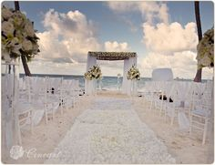 Simple white decor can be the perfect addition to a ceremony by the ocean #DreamsPalmBeachPuntaCana #DominicanRepublic #Destinationwedding
