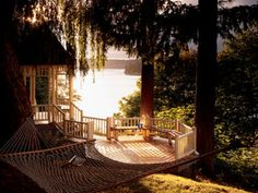 The big idea here is the gazebo-deck, with seating built into the railing. The two octagonal platforms--one open, the other covered--are connected by a slender bridge and stair to form an elegant box seat for a calming water view...or a view of anything!