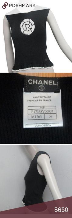 authentic CHANEL size 38 France cotton/silk top 95% cotton, 5% silk.  Black knit sleeveless pullover sweater vest with white signature CAMELLIA flower on front. Small metal CHANEL nameplate at the waist.  VERY RARE & DESIRABLE PIECE.  retail $1500 CHANEL Sweaters