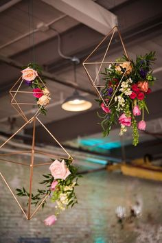 Hanging installations are a terrific way to fill an open space, particularly industrial lofts and high tents. This geometric gold wedding detail looks extra pretty when covered in blush flowers and a few pieces of leafy greenery.