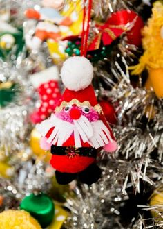 DIY Santa kitschmas ornament on a silver tree.    #diypompomornament