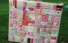 The One Color Scrappy Baby #Quilt proves that simple #patterns for scrap quilts can be just as attractive as other easy baby quilt patterns. Simply choose an assortment of scraps in one color, and your scrappy baby quilt will have perfect harmony.