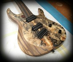 Kiesel Guitars Carvin Guitars  AM7 (Aries Multiscale) Buckeye burl top over black limba body in a satin finish with royal ebony fretbaord