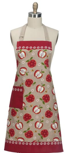 "This charming ""An Apple a Day"" Apron features a tan chambray apron features half and whole red apples, apple blossoms and bees. Apron has a 3-inch red hem, redon neckline - all accented with white apple blossoms.  Apron measures 26"" x 34"". Made of 100% cotton with beautiful embroidered image"