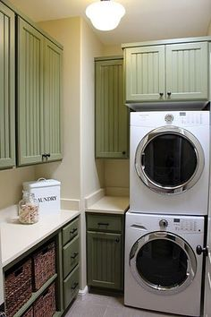 green cabinets in laundry room
