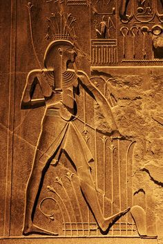 Ancient relief in Luxor temple at night, Luxor, Egypt  (by travelingmipo)