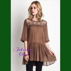 Ruffle Tunic with Crochet Detail A comfortable ruffle tunic with romantic crochet details. Large. Color-Cocoa. Pair with your favorite jeans or leggings. Slightly oversized. Tops Tunics