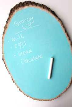 chalkboard paint on wood slice...now that  is cool!