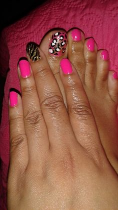 Here, I painted my natural nails in hot pink with Cheetah and Zebra hand painted designs.