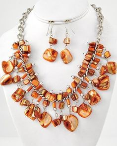 """CHUNKY ORANGE COLOR SHELL SILVER TONE NECKLACE SET    * If you need a necklace extender I have them for sale in my store.*     NECKLACE: 16 5/8"""" + EXT    DROP: 2 3/8"""" LONG    HOOK EARRINGS: 2 1/4"""" LONG    LOBSTER CLAW CLOSURE ON NECKLACE     COLOR: SILVER TONE $20.99"""