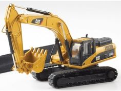 This CAT 336D L Hydraulic Excavator Diecast Model Excavator is Yellow and features working lift arm, tracks. It is made by Norscot and is 1:50 scale.  ...