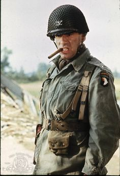 "Lieut-Gen Robert Frederick Sink (3.4.1905|13.12.1965) WWII U.S. Army officer, most famous for his command of the 506th Parachute Infantry Regiment of 101st Airborne Division. The character of ""Colonel Robert Stout"" in the film A Bridge Too Far (1977), played by Elliott Gould, is  based on Sink."