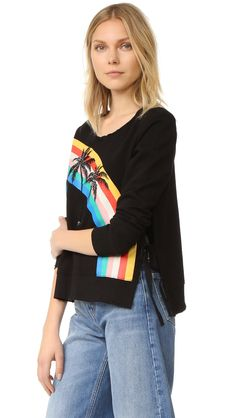 Pam & Gela Women's Sweatshirt with Rainbow, Black, P. Side slits with tie details. Crystal accents on palm tree. Twisted ribbing at neck. Super fine French terry sweatshirt.