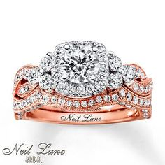 A Neil Lane Bridal engagement ring with complementary wedding band that follows the contours flawlessly, all in rose gold.