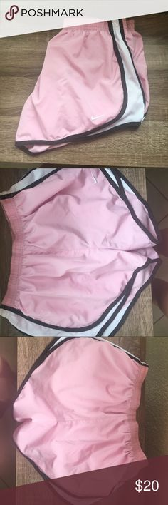 Nike dri fit tempo running shorts Nike dri fit tempo running shorts in pink, black, and white. In excellent condition except back has some hardly noticeable, light markings (pictured) so item Is priced accordingly! .  Lightweight and built in briefs. Machine washable Nike Shorts