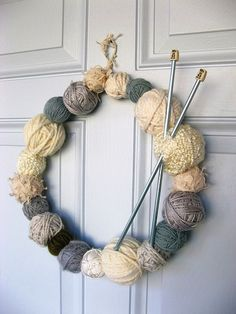 Do you have a passion for knitting? Why not use some of your leftover supplies to make a yarn-ball wreath. You will need a few balls of yarn, a wire coat hanger and a pair of knitting needles. Knitting Projects, Crochet Projects, Knitting Patterns, Crochet Ideas, Knitted Christmas Decorations, Christmas Crafts, Christmas Ornaments, Xmas, Christmas Door